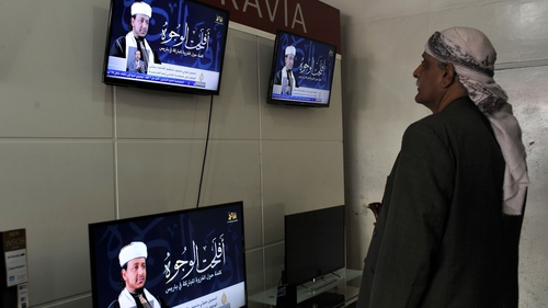 Nasser bin Ali al-Ansi pictured on the tv screens was killed with his son and other fighters
