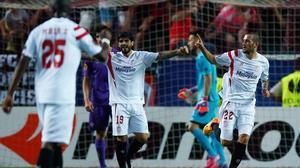 Aleix Vidal (r) of Sevilla celebrates the opener