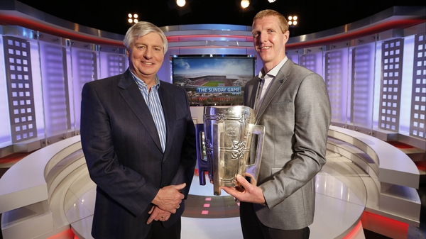 Michael Lyster and new Sunday Game analyst Henry Shefflin with the Liam MacCarthy Cup