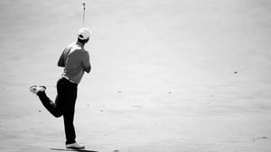Tiger Woods plays his second shot on the on the 16th hole