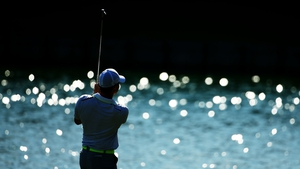 Rory McIlroy plays his second shot on the 18th