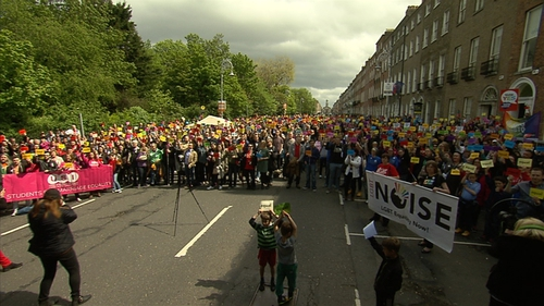 People attend the rally in Merrion Square
