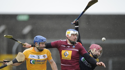 Antrim's John Dillon and Chris O'Connell with Brendan Murtagh of Westmeath