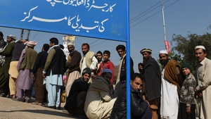 Afghan refugees queue to register in Pakistan