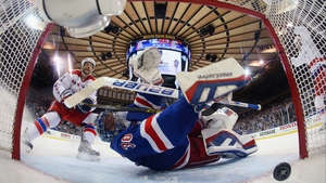 Brooks Laich of the Washington Capitals watches a shot enter the net past Henrik Lundqvist of the New York Rangers in the 2015 NHL Stanley Cup play-offs at Madison Square Garden, New York