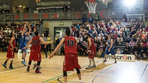 Colin O'Reilly of C&S UCC Demons tries to get the ball in the hoop