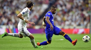 Patrice Evra (R) in action against Real Madrid's Gareth Bale
