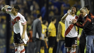 River Plate players in distress after being sprayed by Boca Junior fans