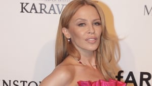 Kylie Minogue has enlisted James Corden's help for her Christmas album