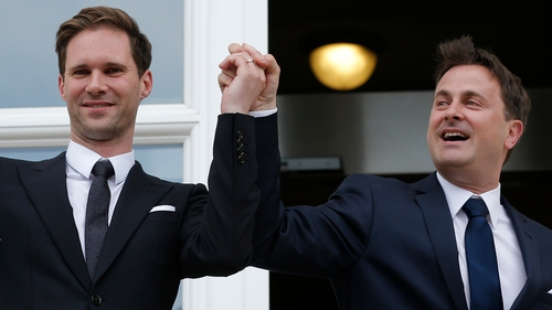 Prime Minister Xavier Bettel (R) and Gauthier Destenay (L) are pictured following the private ceremony