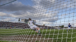 Offaly goalkeeper Alan Mulhall saves a penalty from Longford's Michael Quinn