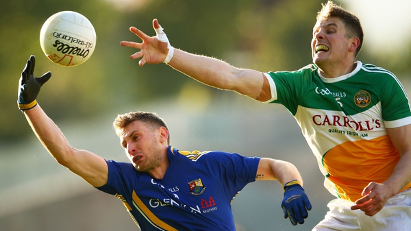 Offaly's Johnny Moloney and Ronan McEntire of Longford contest a loose ball