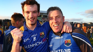 Longford's Barry Gilleran and manager Jack Sheedy celebrate victory