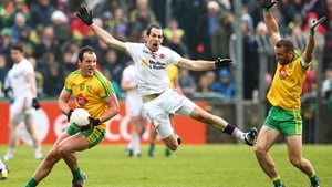 Donegal's Michael Murphy on the ball with Neil McGee and Justin McMahon in close attendance