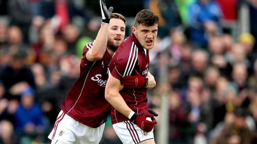 Damien Comer (r) goaled for Galway just before half-time
