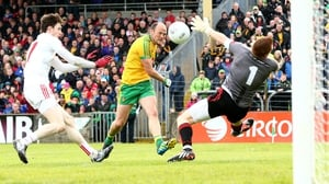 Donegal's Colm McFadden has his shot saved by goalkeeper Michael O'Neill of Tyrone