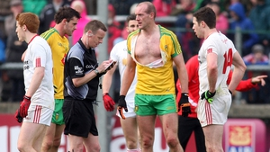 Donegal's Neil Gallagher loses his shirt - before being shown a second yellow card by Joe McQuillan