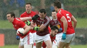 Louth's Bevan Duffy and John Stapleton of Westmeath battle for possession as the rain falls