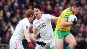 Donegal's Patrick McBrearty evades Tyrone's Peter Harte and Mattie Donnelly