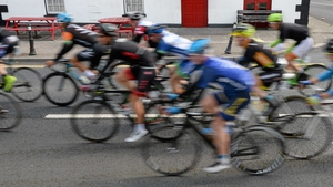 The peloton makes its way past The Chaser pub in Pallasgreen, Co Limerick