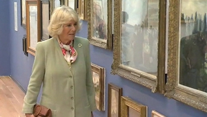 The Duchess of Cornwall admires pieces of artwork displayed in the Model Arts Centre