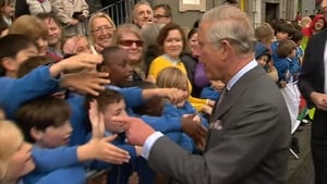 The Prince of Wales shakes hands with some local schoolchildren