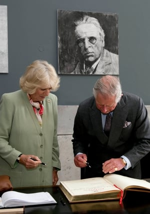 Prince Charles and Camilla sign the visitors' book