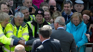 Prince Charles shakes hands with members of the public