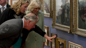 Prince Charles and his wife are given a tour of the Model Arts Centre