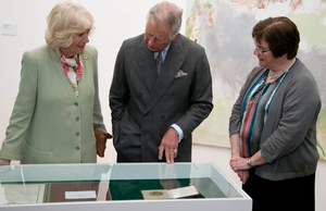 Britain's Prince Charles and his wife are shown pieces from the Niland Art Collection