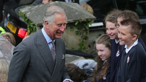 Prince Charles meets some local children before entering the Model Arts Centre