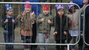 Local children wait for the Royal couple to arrive