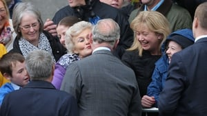 The Prince of Wales gives Marie Conlon a kiss on her 72nd birthday