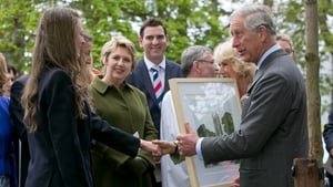The Prince of Wales and his wife are presented with a painting in Drumcliffe