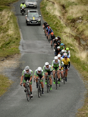 Joshua Edmondson of An Post Chain Reaction is followed by team-mates, Aaron Gate, evenual stage 4 winner Aidis Kruopis, and Conor Dunne