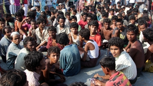 Refugees from Myanmar and Bangladesh are seen in a camp after their rescue in Sumatra, Indonesia