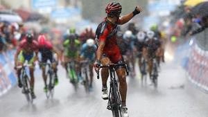 Philippe Gilbert of the BMC team celebrates as he crosses the finish line