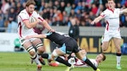 Iain Henderson is tackled by Henry Pyrgos