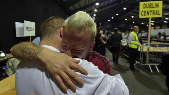Michael Barron (L) and Jamie Nanci (R) who were married in Cape Town, South Africa embrace at the RDS count centre