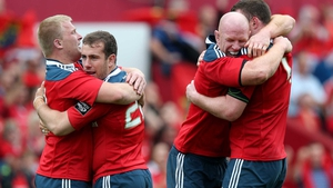 Munster players embrace at the final whistle