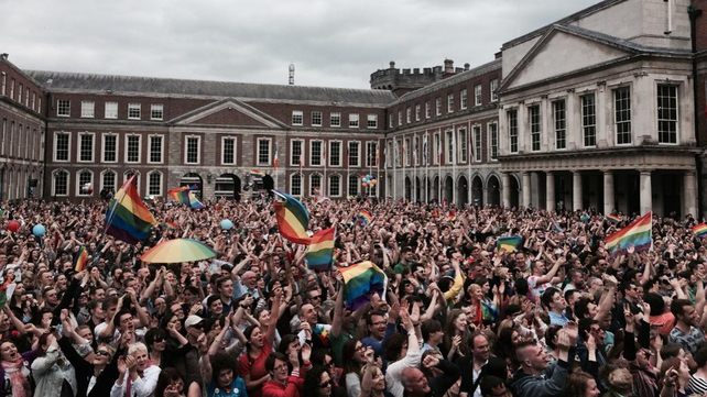 Crowds celebrate the official result outside Dublin Castle