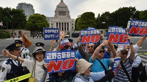 Demonstrators are angry over plans to build a new US airbase in Okinawa