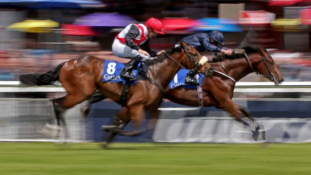 Air Force Blue ridden by Ryan Moore (inside) comes home to win