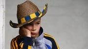 A young Clare fan eagerly awaits the game at Semple