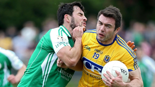 London's Martin Carroll feels the shoulder of Roscommon's Ian Kilbride