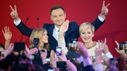Andrzej Duda with his wife Agata Kornhauser-Duda react on the first projections during presidential election night in Warsaw