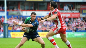 Connacht's Robbie Henshaw under pressure from Gloucester's James Hook during the game