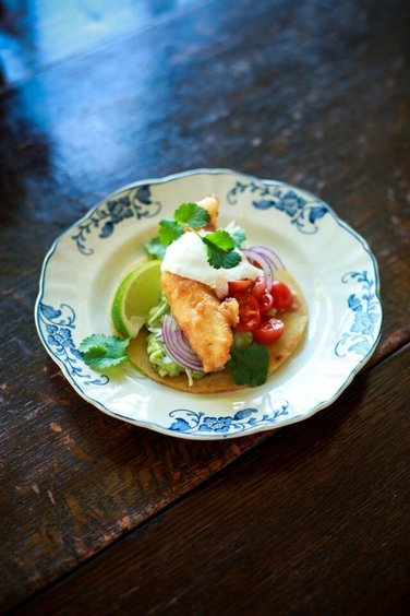 Beer Batter Fish Tacos with Cherry Tomato Salsa  - This is a great recipe of tortillas filled with shallow fried fish goujons, tomato salsa, a little soured cream and some salad. Perfect served with ice cold beer for the grown ups…