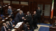 Bobby Aylward shakes hands with Micheál Martin before taking his seat