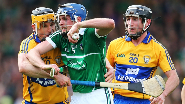 Limerick's Gavin O'Mahony feels the pressure from his Clare minders at Semple Stadium last weekend